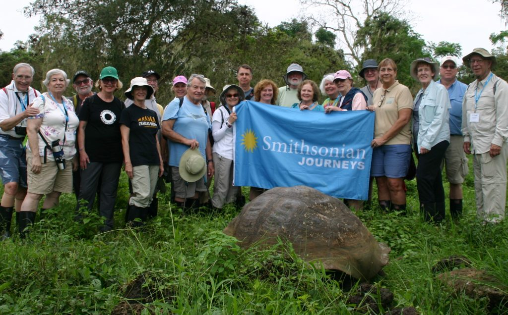 smithsonian group with giant boulder